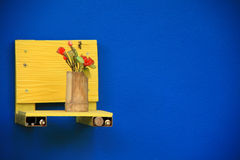 Bamboo flower vase on a blue background. Texture Royalty Free Stock Image