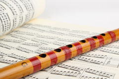 Bamboo flute and Music Sheet Royalty Free Stock Photography