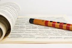 Bamboo flute and Music Sheet Stock Photos
