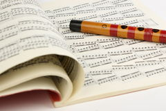 Bamboo flute and Music Sheet Stock Photo