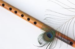 Bamboo flute, peacock feather Royalty Free Stock Photos