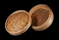 Bamboo Food Steamer LidRaised. Bamboo food steamer with lid, raised angle view, black iso Stock Images