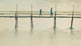 Bamboo footbridge across the river length of about 40 meters stock video footage