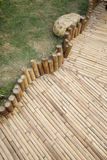 Bamboo footpath. Next to a garden royalty free stock images