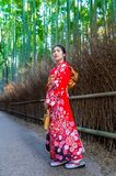 Bamboo Forest. Asian woman wearing japanese traditional kimono at Bamboo Forest in Kyoto, Japan stock photo