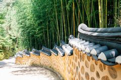 Bamboo forest and Korean traditional stone wall street. Bamboo forest and Korean traditional stone wall royalty free stock image