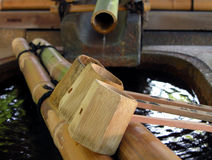 Bamboo Fountain With Ladles Stock Photo