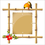 Bamboo frame. With a blank sheet of papyrus Royalty Free Stock Image