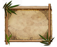 Bamboo frame. On grunge paper with leaves on white backgound Stock Images