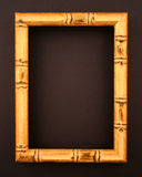 Bamboo frame on black surface Royalty Free Stock Photos