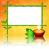 Bamboo frame and candle Royalty Free Stock Photography