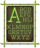 Bamboo frame with canvas and alphabet Royalty Free Stock Images