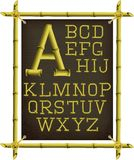 Bamboo frame with canvas and alphabet. Bamboo frame with canvas and stylized alphabet Stock Images