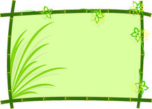 Bamboo Frame With grass and flower Stock Photography