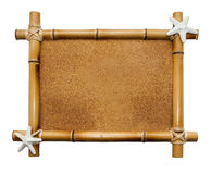 Bamboo frame isolated on white background. Bamboo frame with cork background looking like a sand isolated on white stock image