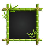 Bamboo frame with leafs isolated on white Stock Photography