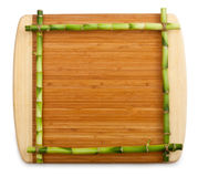 Bamboo frame made of stems on cutting board Stock Images