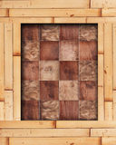 Bamboo frame with wooden squares in a checkerboard pattern. Bamboo frame with wood squares in a checkerboard pattern Royalty Free Stock Image