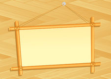 Bamboo frame on wooden wall Royalty Free Stock Photos