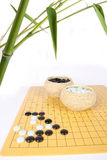 Bamboo and the game of go. Traditional asian cultures, bamboo and the game of go royalty free stock photos