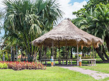Bamboo gazebo with straw roof. In the park Royalty Free Stock Images