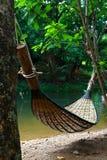 Bamboo hammock. The bamboo hammock on a green river side Stock Photo