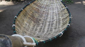 Bamboo hammock moving in the garden stock video footage