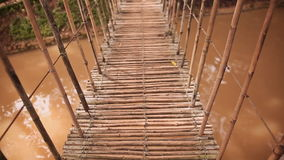 Bamboo hanging bridge over river in tropical forest, Bohol, Philippines stock video