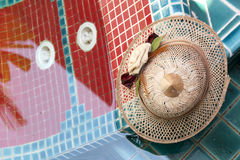 A bamboo hat at pool Stock Photography