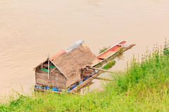 Bamboo house on the river Stock Images