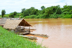 Bamboo house on the river Stock Photos