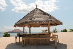 Bamboo hut as a bar on the beach, Indonesia. Bamboo hut as a bar on the beach, Kanawa island, Indonesia Royalty Free Stock Images