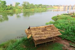 Bamboo hut and farmer's garden at riverside view Royalty Free Stock Image