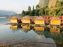 4 Bamboo hut. Reflect on water in the morning at Ratchaprapa Da, Khaosok National Park, Suratthani, Thailand Stock Illustration