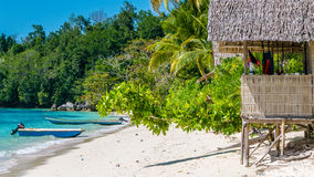 Bamboo Hut under Palm Trees of an Homestay on Gam Island, West Papuan, Raja Ampat, Indonesia Stock Images