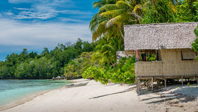 Bamboo Hut under Palm Trees of an Homestay on Gam Island, West Papuan, Raja Ampat, Indonesia Stock Image