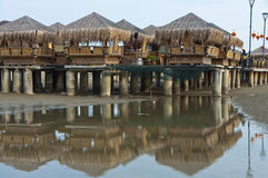 Bamboo Huts at Beach Side. Water reflection of the bamboo huts Stock Image