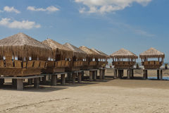 Bamboo Huts at Beach Side. Water reflection of the bamboo huts Royalty Free Stock Photo