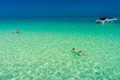 Bamboo island, Thailand - February 2, 2014:  Tourist swimming an Royalty Free Stock Images