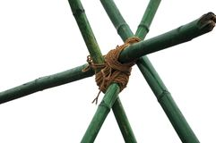 Bamboo knots with rope. Bamboo tied together in knots with jute rope royalty free stock image
