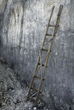 Bamboo Ladder in the limestone wall Stock Photography