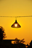 Bamboo lamp in the sunset Royalty Free Stock Image