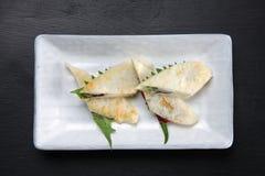 Bamboo-leaf-shaped fish cake called sasa-kamaboko. Studio shot of bamboo-leaf-shaped fish cake called sasa-kamaboko on a dining table royalty free stock photos