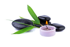 Bamboo Leaf and Zen Pebbles. Candle over white, spa concept stock image