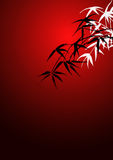 Bamboo leaves. On a red background Royalty Free Stock Image