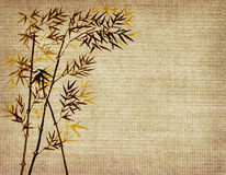 Bamboo leaves on old grunge background Royalty Free Stock Photography