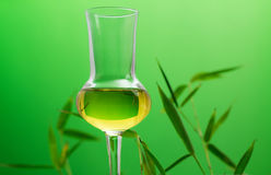 Bamboo liqueur over green Stock Photos