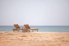 Bamboo loungers на пляже Стоковое Изображение RF