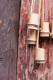 Bamboo made scoops. Hanging on the wooden wall Stock Photo