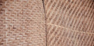 Bamboo made surface unique background photo. Brown coloured bamboo made surface unique abstract background photo stock image